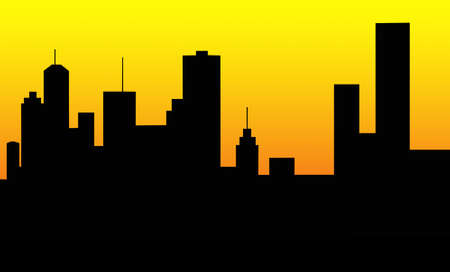 silhouette of a large city skyline at sunrise Stock Photo
