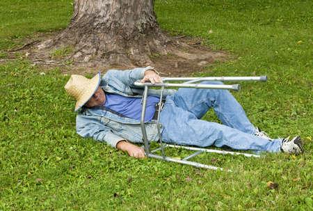 elderly man with a walker falls in the park Standard-Bild