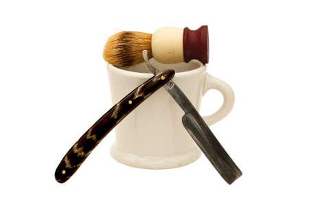 vintage straight razor with soap mug and brush