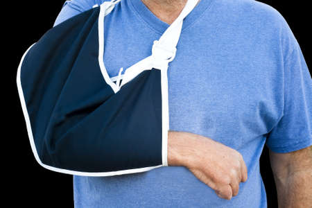 closeup of a cloth support sling on a mans arm Stock Photo