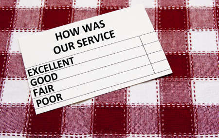 customer service survey card on a checkered tablecloth Stock Photo - 12791716