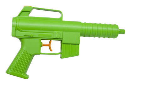 childs plastic water pistol isolated on white photo