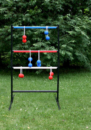 ladder ball game set up in a suburban back yard Stockfoto