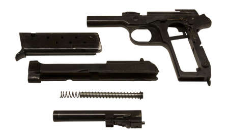 semi-auto pistol broken down for cleaning or maintenance Banco de Imagens