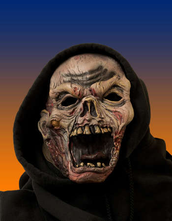 freaky: portrait of a zombie in a black cloth hood Stock Photo