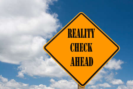 sign indicating that a reality check is straight ahead Stock Photo