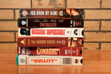RIVER FALLS,WISCONSIN-JANUARY 14,2014:  Stack of vintage VHS tapes. The first VCR to use VHS was marketed in 1976.