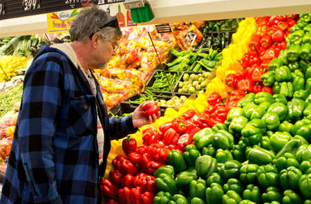 Eau CLAIRE,WISCONSIN-FEBRUARY 03,2014: Man shopping at a Festival supermarket in Eau Claire,Wisconsin on February 03,2014.