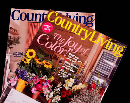 country living: RIVER FALLS,WISCONSIN-MARCH 13, 2014: Two issues of Country Living Magazine. Country Living is a publication dedicated to the country lifestyle and decoration.