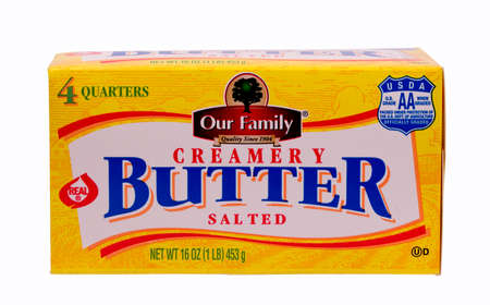 our: RIVER FALLS,WISCONSIN-MARCH 14, 2014: A carton of Our Family salted butter. Our Family brand is owned by Nash Finch Company of Edina,Minnesota Editorial