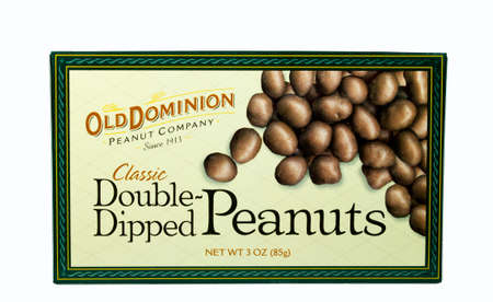 dominion: RIVER FALLS,WISCONSIN-MARCH 17, 2014: A box of Old Dominion Chocolate Covered Peanuts. Old Dominion Peanut Company was founded in Nineteen Thirteen in Norfolk,Virginia.