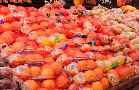 RIVER FALLS,WISCONSIN-FEBRUARY 04, 2014: Bags of apples and oranges in the produce section of a supermarket on February 04,2014 in River Falls,Wisconsin. Editoriali