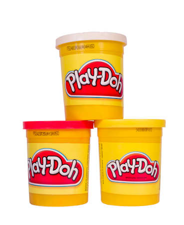 playdoh: RIVER FALLS,WISCONSIN-APRIL 25, 2014: Three cans of Play-Doh. Play-Doh is a modeling compound used by children in art and craft projects. Editorial