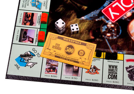 RIVER FALLS,WISCONSIN-MAY 06, 2014: This is the official edition of the Harley-Davidson Monopoly game with money and dice.