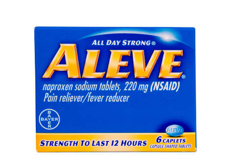 ag: RIVER FALLS,WISCONSIN-JUNE 18,2014: A package of Aleve naproxen sodium tablets. Aleve is a product of Bayer AG of Germany.
