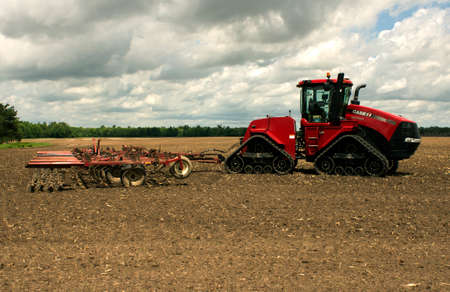 RIVER FALLS,WISCONSIN-JUNE 02,2014: A Case Quadtrac 500 tractor with a large disk harrow attached near River Falls,Wisconsin on June 02,2014