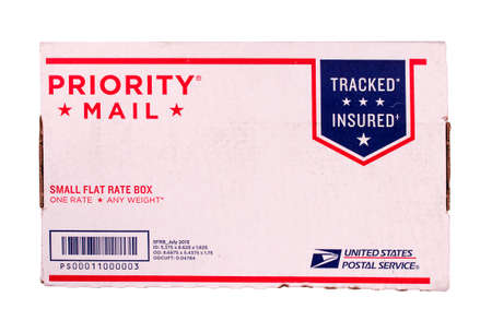 RIVER FALLS,WISCONSIN-AUGUST 04,2014: A United States Postal Service priority mail carton. Benjamin Franklin was appointed the fires postmaster general in 1775.