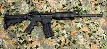 camoflauge: An AR-15 rifle on a generic camoflauge background