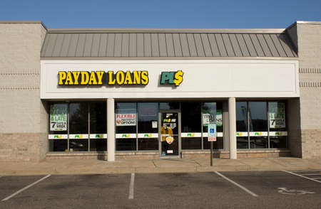 RIVER FALLS,WISCONSIN-OCTOBER 20,2014: Payday Loans retail storefront. Payday Loan LLC is headquartered in Anaheim,California. Redactioneel