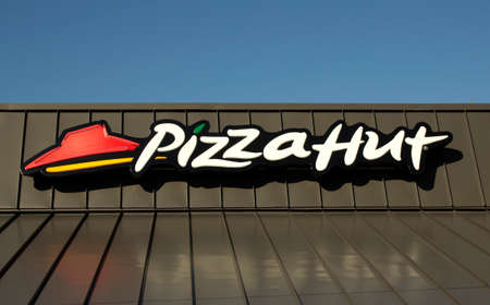 RIVER FALLS,WISCONSIN-DECEMBER 05,2014: The Pizza Hut logo on a metal roof. Pizza Hut was founded in Nineteen Fifty Eight in Wichita,Kansas.