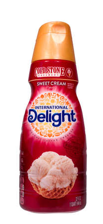 creamer: RIVER FALLS,WISCONSIN-DECEMBER 28,2014: A bottle of Cold Stone coffee creamer by International Delight. Cold Stone Creamery is an American ice cream parlor chain.