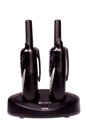 two way: RIVER FALLS,WISCONSIN-DECEMBER 30,2014: A pair of Cobra brand two way radios with charging stand. Cobra Electronics Corporation is headquartered in Chicago. Editorial
