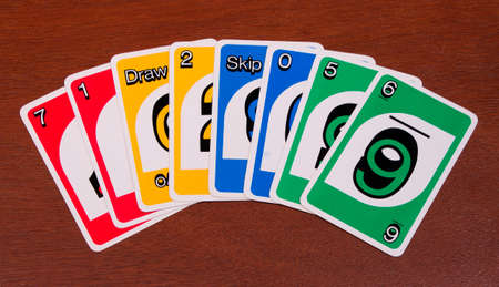RIVER FALLS,WISCONSIN-JANUARY 30,2015: A collection of eight Uno playing cards. Uno has been distributed my Mattel since Nineteen Ninety Two.