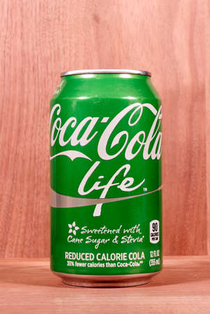 fewer: RIVER FALLS,WISCONSIN-MARCH 10,2015: A can of Coca-Cola Lite. This soda has thirty five percent fewer calories than regular Coca-Cola.