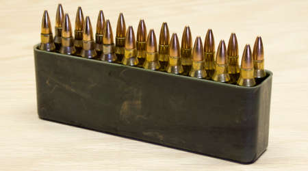 projectile: A plastic case filled with rifle ammunition Stock Photo