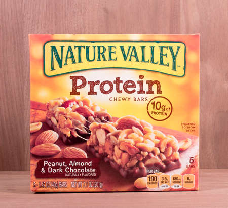 chewy: RIVER FALLS,WISCONSIN-MARCH 19,2015: A box of Nature Valley chewy protein bars. Nature Valley products are a brand  owned by General Mills Incorporated.
