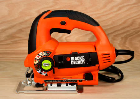 jig: RIVER FALLS,WISCONSIN-MARCH 21,2015: A Black and Decker jig saw with Accu-Bevel. Black and Decker is headquartered in Towson,Maryland.