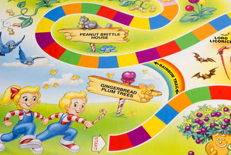 RIVER FALLS,WISCONSIN-APRIL 1,2015: A Candy Land game board showing the start position. Candy Land was first published in Nineteen Forty Nine by Milton Bradley.