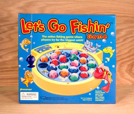 pressman: RIVER FALLS,WISCONSIN-APRIL 1,2015: A Lets Go Fishing game box by Pressman Toy Corporation. Pressman Toys was bought by Goliath Games in Twenty Fourteen.