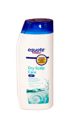 RIVER FALLS,WISCONSIN-APRIL 9,2015: A bottle of Equate Dry Scalp shampoo. Equate is a store brand of Walmart Incorporated.