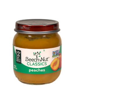 RIVER FALLS,WISCONSIN-JUNE 01,2015: A jar of Beech-Nut peaches baby food. This product is distributed by Beech-Nut Nutrition Corporation.
