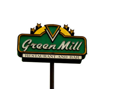 headquartered: RIVER FALLS,WISCONSIN-JUNE 02,2015: A retail sign for Green Mill restaurant and bar. Green Mill is headquartered in Saint Paul,Minnesota. Editorial