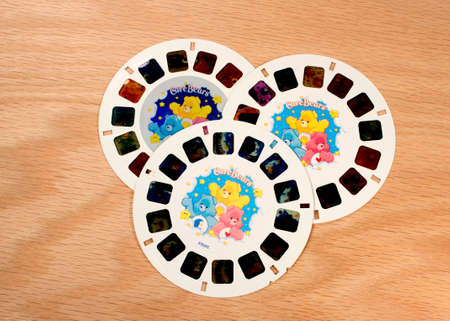 stereoscope: RIVER FALLS,WISCONSIN-JULY 16,2015: A group of Care Bears View-Master disks. The Care Bears were created by American Greetings Corporation in Nineteen Eighty One.