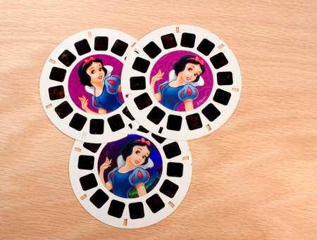 seven dwarfs: RIVER FALLS,WISCONSIN-JULY 17,2015: Three vintage Snow White and the Seven Dwarfs View-Master disks. Walt Disney made a movie based on this story in Nineteen Thirty Seven.