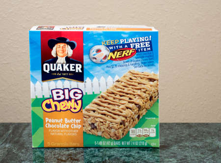quaker: RIVER FALLS,WISCONSIN-JULY 24,2015: A box of Quaker brand Big and Chewy granola bars. Quaker Oats Company has been owned by PepsiCo since Two Thousand One. Editorial