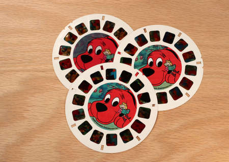 scholastic: RIVER FALLS,WISCONSIN-JULY 30,2015: Three View-Master disks of Clifford the Big Red Dog. This tale was published by Scholastic Books Incorporated.