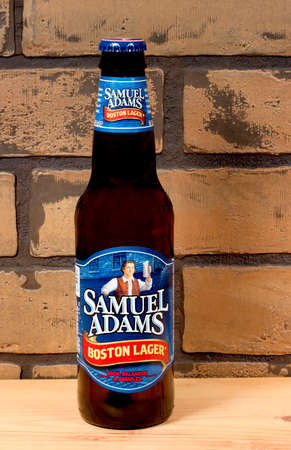 intoxicant: RIVER FALLS,WISCONSIN-JULY 31,2015: A bottle of Samuel Adams Boston Lager beer. Samuel Adams beer is produced by the Boston Beer Company.