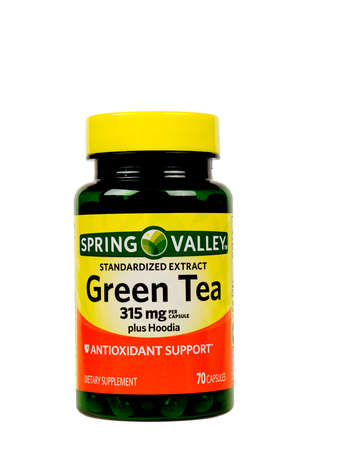 RIVER FALLS,WISCONSIN-SEPTEMBER 06,2015: A bottle of Spring Valley brand Green Tea capsules. This product is distributed by Wal-Mart Stores Incorporated.