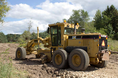 RIVER FALLS,WISCONSIN-SEPTEMBER 13,2015: A Caterpillar brand road grader. Caterpillar is the worlds largest manufacturer of construction and mining equipment.