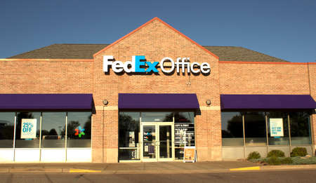 headquartered: RIVER FALLS,WISCONSIN-SEPTEMBER19,2015: FedExOffice storefront. FedEx Corporation is headquartered in Memphis,Tennessee. Editorial