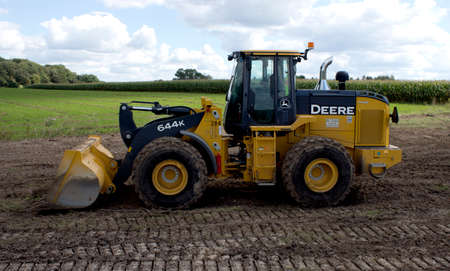 deere: RIVER FALLS,WISCONSIN-SEPTEMBER22,2015: A large John Deere front end loader. Deere and Company is headquartered in Moline,Illinois.