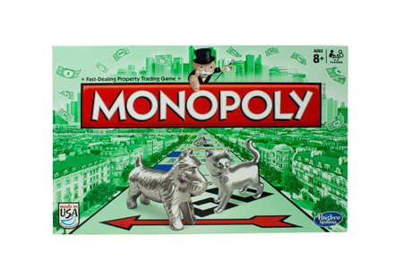 board: RIVER FALLS,WISCONSIN-NOVEMBER 01,2015: A Monopoly game box by Hasbro. Monopoly is a board game that originated in the United States in Nineteen Hundred and Three.