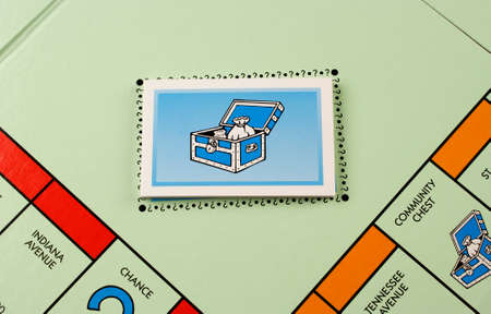 RIVER FALLS,WISCONSIN-NOVEMBER 06,2015: A Monopoly board featuring the Community Chest cards. Monopoly originated in the United States in Nineteen Hundred and Three.