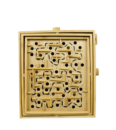 A closeup view of a wooden labyrinth game