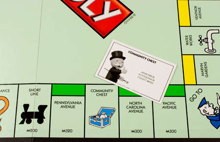 RIVER FALLS,WISCONSIN-NOVEMBER 23,2015: A closeup view of a Monopoly board featuring the Community Chest card.