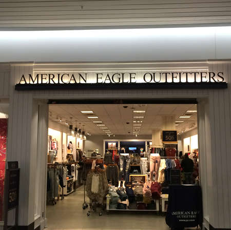 eagle falls: RIVER FALLS,WISCONSIN-FEBRUARY 15,2016: The American Eagle Outfitters sign and retail store. American Eagle is headquartered in Pittsburgh,Pennsylvania.